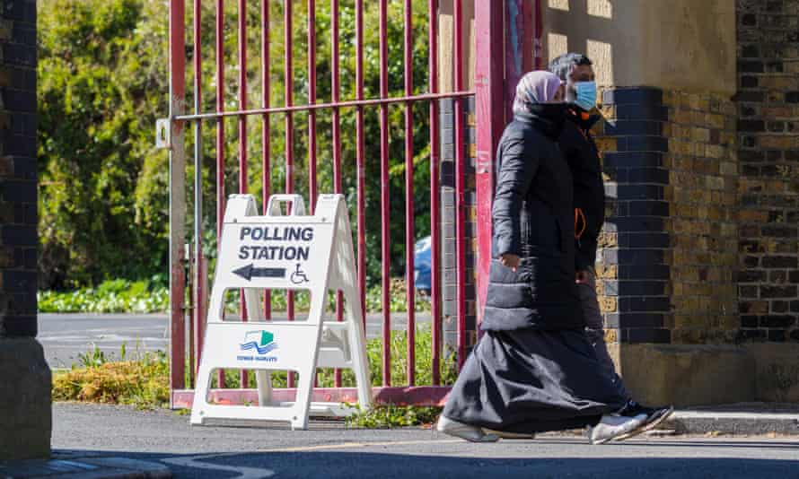People leave a polling station in Tower Hamlets, London.