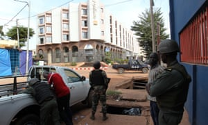 Malian policemen and security officials guard the Radisson hotel