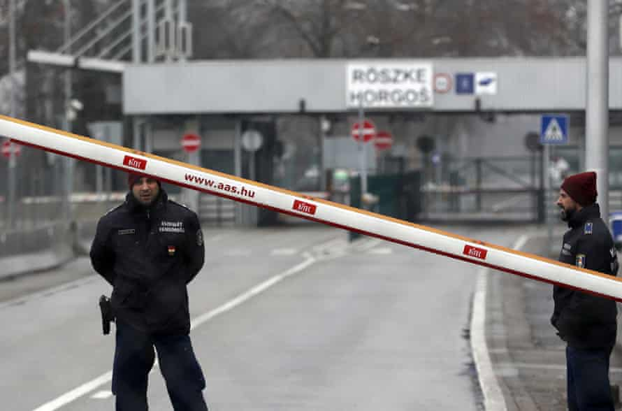 """Hungarian police guard the closed """"Horgos 2"""" border crossing into Hungary"""