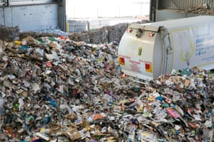 A truck unloads recyclable materials, collected in the kerbside yellow bins, at the Hume recycling site.