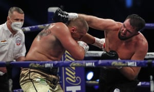 Britain's Hughie Fury throws a punch at Poland's Mariusz Wach.