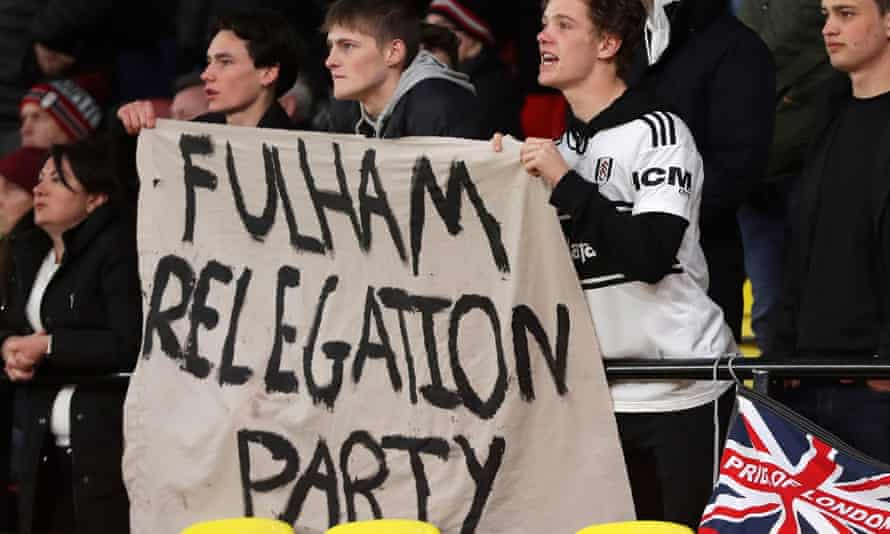Fulham fans try to keep their spirits up at Vicarage Road.