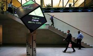 People walk into the London Stock Exchange