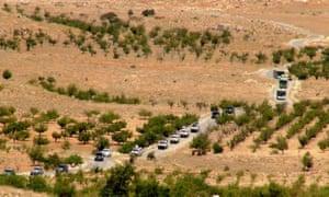 Vehicles make their way through Lebanon as part of the repatriation