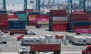 Shipping containers from China and Asia are unloaded at the Long Beach port, California, on Thursday.