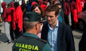 PP party leader Pablo Casado speaks to a member of the Spanish Civil Guard during a visit to the harbour of Algeciras.