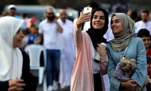 Women taking selfie