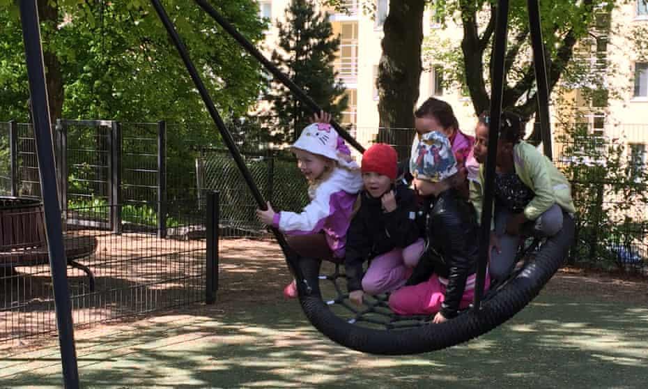 Children on large swing