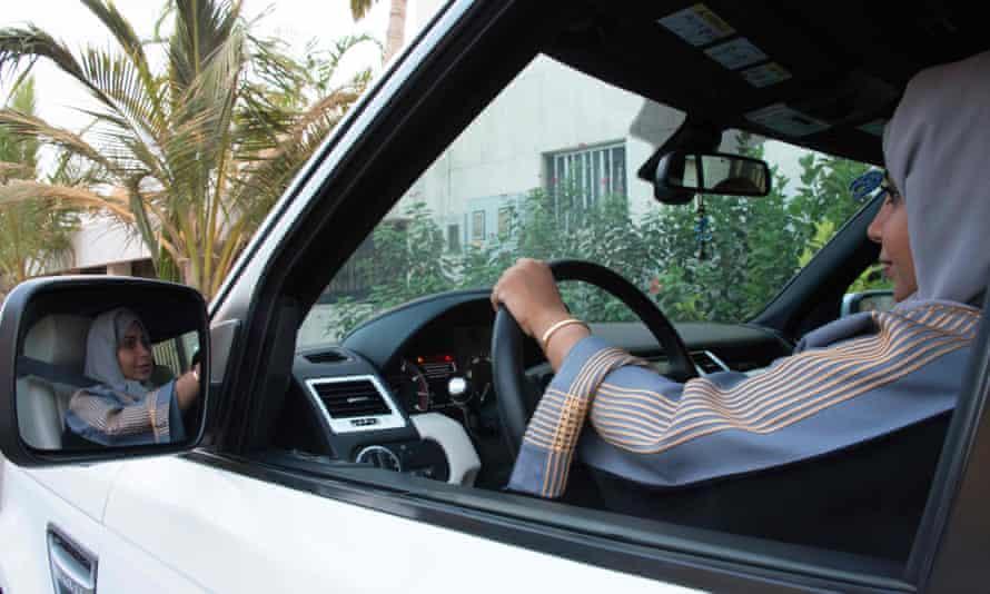 A Saudi woman driving her car along a street in the coastal city of Jeddah.
