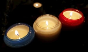 Candles in the colours of the French flag outside the Bataclan concert hall, one of the sites of the terrorist attacks in Paris on 13 November. They were lit in a ceremony to pay tribute to victims that was held on Friday, a week after the bombings and shootings.