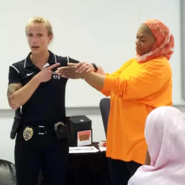 Toni Weinbeck of the Brooklyn Park police department instructing Tuere Tidwell at a self defense class for Muslim women.