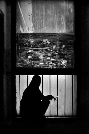 A girl smokes in a dangerous block in Petrzalka, a district of Bratislava