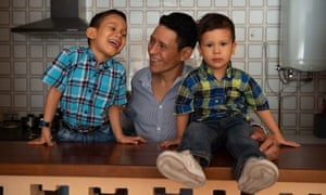 Angel Marquez, 45, a teacher from Venezuela, with his two sons in Pareja, central Spain.