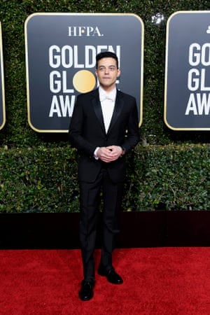 Rami Malek opted for a Givenchy white bow-tie tux.