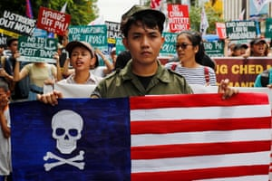 Protesters hold flags and placards in Manila, the Philippines