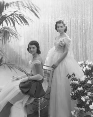 Jacqueline Bouvier, seated, with her sister Caroline Lee Bouvier, wearing ball gowns, photographed for Vogue in 1951