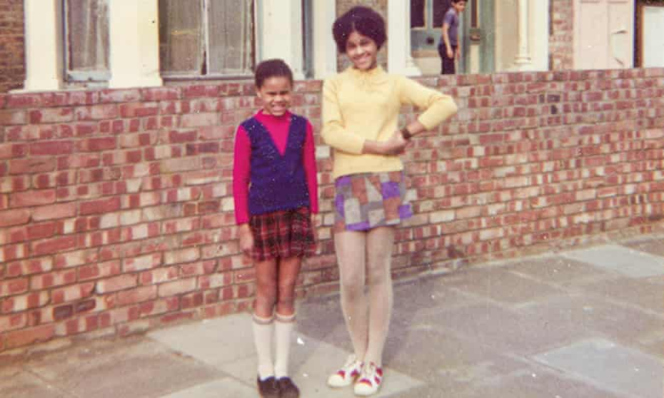 Bernardine Evaristo, right, with younger sister Charlotte outside their childhood home in 1972