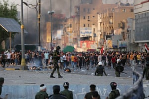Demonstrators face police during an anti-government protest in Baghdad, Iraq.