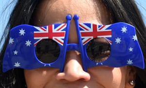 A woman with Australian flags on her sunglasses