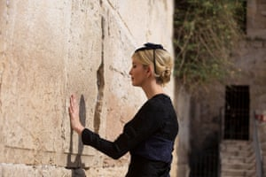 Ivanka Trump touches the Western Wall, where she left a private note of prayer