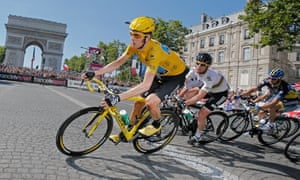 Bradley Wiggins is followed by team-mate Mark Cavendish as they pass the Arc de Triomphe in Paris in 2012