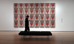 A woman walks past Campbell's Soup Cans by Andy Warhol during a press preview on 10 October.