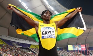 Tajay Gayle of Jamaica, gold, celebrates after the men's long jump final.