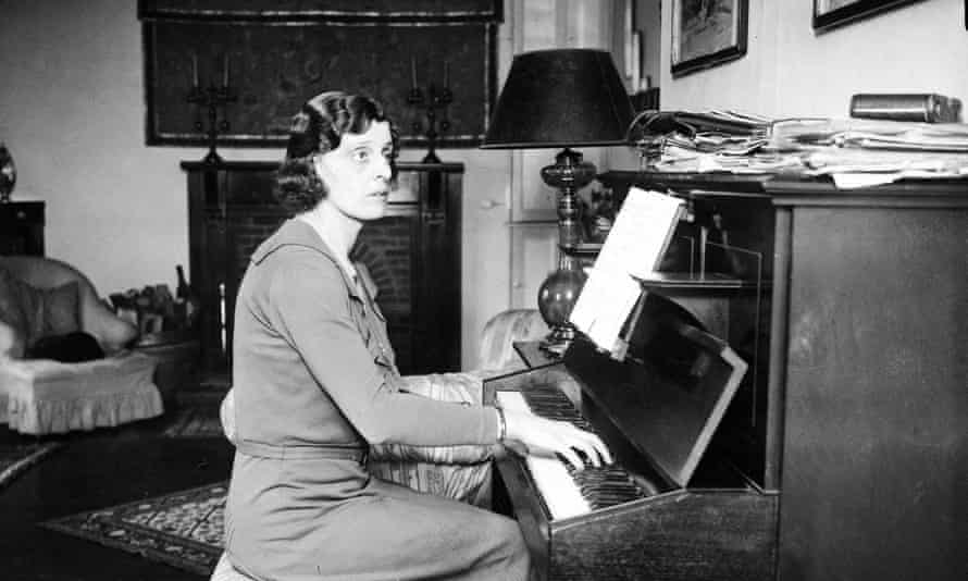 EM Delafield at a piano, mid 1930s.