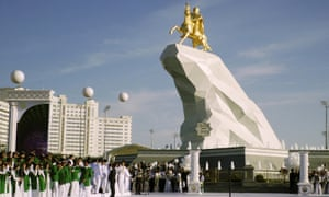 People gather in Ashgabat for the unveiling of a gold-leaf statue of president Gurbanguly Berdymukhamedov atop a horse.