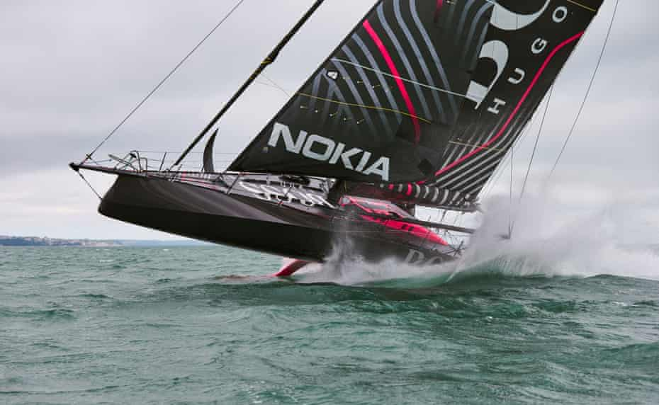 Thomson helms the Hugo Boss IMOCA 60 during a training session.