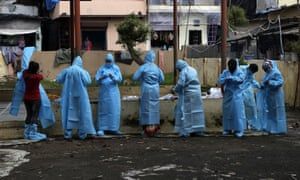 Indian health workers prepare to screen residents for Covid-19 symptoms in Deonar, Mumbai.