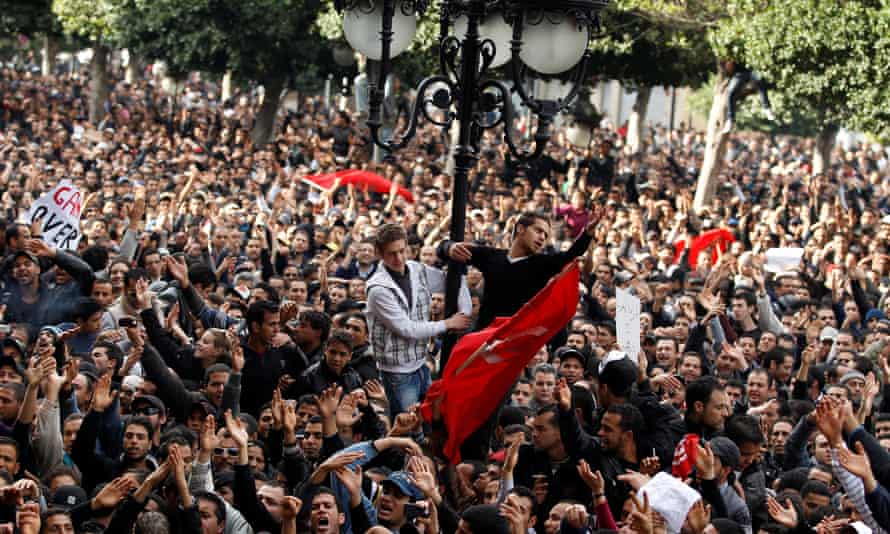 Protesters demonstrating in Tunis against Ben Ali in 2011.