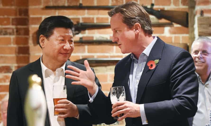 David Cameron and Xi talk as they drink a pint of beer at a pub in Princess Risborough near Chequers.