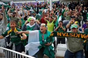 Pakistan fans celebrate.
