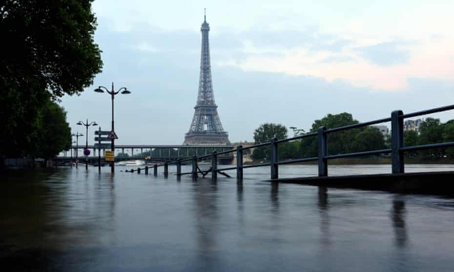 Eiffel Tower in front of the flooded Seine river in front Beaugrenelle in Paris.