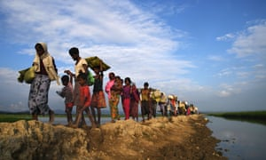 In November last year, Rohingya Muslims make their way to the Balukhali refugee camp after crossing the border in Bangladesh's Ukhia district