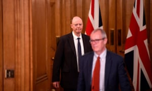 Chris Whitty, the Chief Medical Officer for England and Patrick Vallance, UK Government Chief Scientific Adviser arrive to attend a news conference with Britain's Prime Minister Boris Johnson, in response to the ongoing situation, 19 December