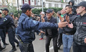 Security forces contain protesters during an anti-government demonstration in Algiers