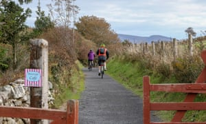 People cycling on the Great Western Greenway, in County Mayo