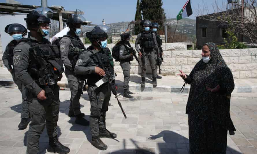 A Palestinian woman protests in the Israeli-occupied West Bank