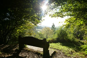 Bench in the foreground and looking south from Ide Hill.  The seat is dedicated to Octavia Hill, the Victorian Open Space Champion who founded the National Trust
