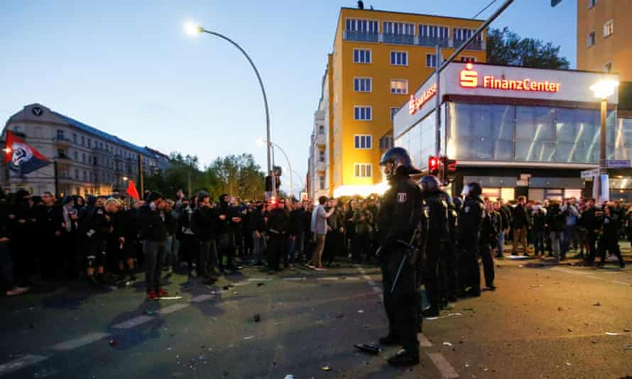 Security forces face protesters in Berlin on Wednesday.
