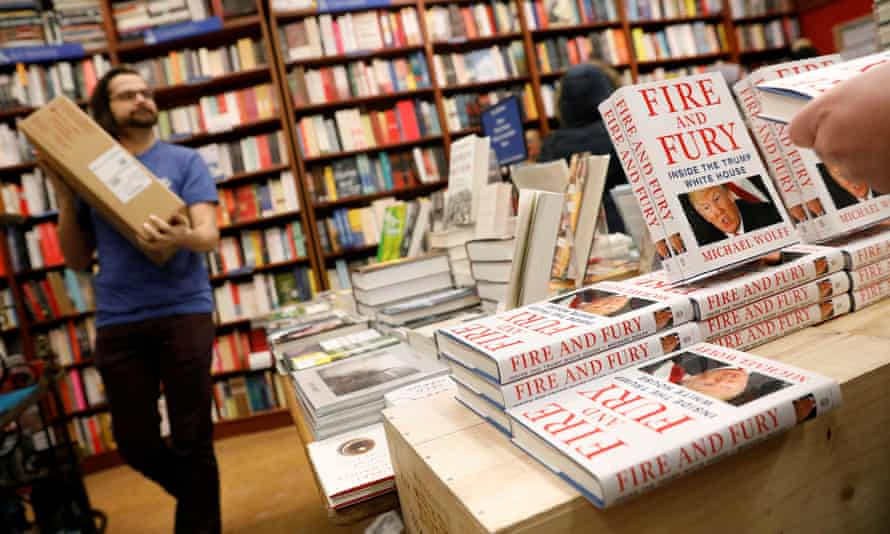 a New York bookshop employee brings in copies of Fire and Fury on Friday for its in-store display.