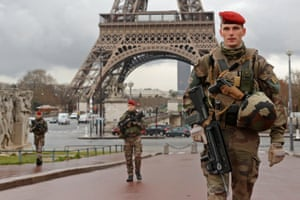 French army paratroopers patrol near the Eiffel Tower in Paris