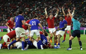 Wales players celebrate after Ross Moriarty scores.