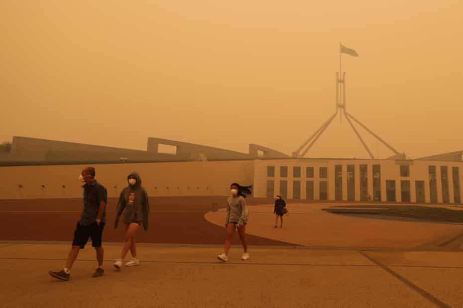 Visitors to Parliament House in Canberra wear face masks as bushfire smoke blankets the Australian capital in January 2020.