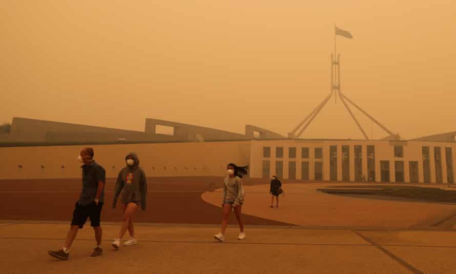 'Sociologist Ulrich Beck wrote that smog is the great equaliser; none of us can escape it. But smog, and smoke, do not affect us equally.' Visitors to Parliament House in Canberra wear face masks after hazardous smoke from bushfires blankets the city.