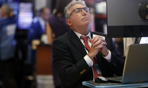 Trader John Bishop works on the floor of the New York Stock Exchange on 7 August. The market has been roiled the past couple of weeks by growing anxiety as the US and China clash over trade.