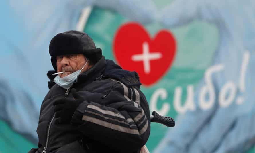 A man sits outside a health clinic near Moscow, Russia.