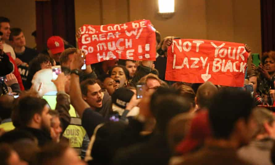 Protesters try to disrupt a rally for Trump in St Louis, Missouri.